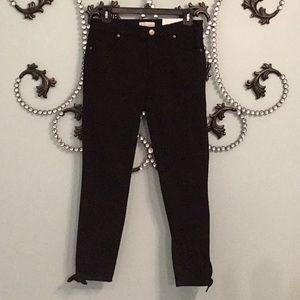 LOFT black denim jeans with bow detail.